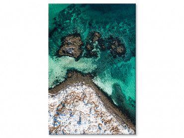 Tableau roche enneigée et mer turquoise